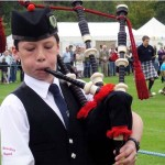 A Scottish Boy Couldn't Stand a Preacher's Homophobic Rant. So He Whipped Out His Bagpipes.