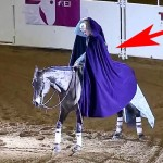 A Woman Rides Up On a Horse and Removes Her Cape. What She Does Next Is Absolutely Stunning.