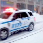 A Man Goes Snowboarding Through 'Times Square' During the Blizzard. Now Watch What the NYPD Does.