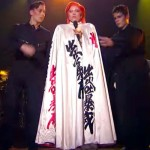 Lady Gaga Goes Onstage for Her 'David Bowie' Tribute. Now Watch When the Dancers Rip Off Her Cape.