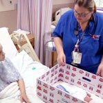 A Nurse Puts a Mom's Newborn In a Cardboard Box. Then, She Touches the Bottom and Feels It…