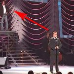 Michael Buble Thinks the Audience Is Clapping for Him. But Look Who's Standing On the Stairs.