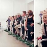 A Toddler With Down Syndrome Steals Wedding Guests' Hearts When He Walks Down the Aisle.