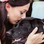 A Bride Breaks Down In Tears While Carrying Her Dying Dog Down the Aisle On Her Wedding Day.