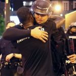 A Black Man Offers Free Hugs to White Cops During the Charlotte Riots. And the Result Is Shocking.