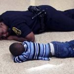 An Indiana Cop Lies On the Floor With a Kid Having a Bad Day.