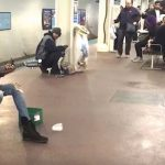 A Subway Performer Stops Crowd With Her Guitar Skills, Then She Lifts Her Head Up and Sings.