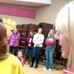 Little girl is called up in front of the whole school, then teacher approaches her in tears.