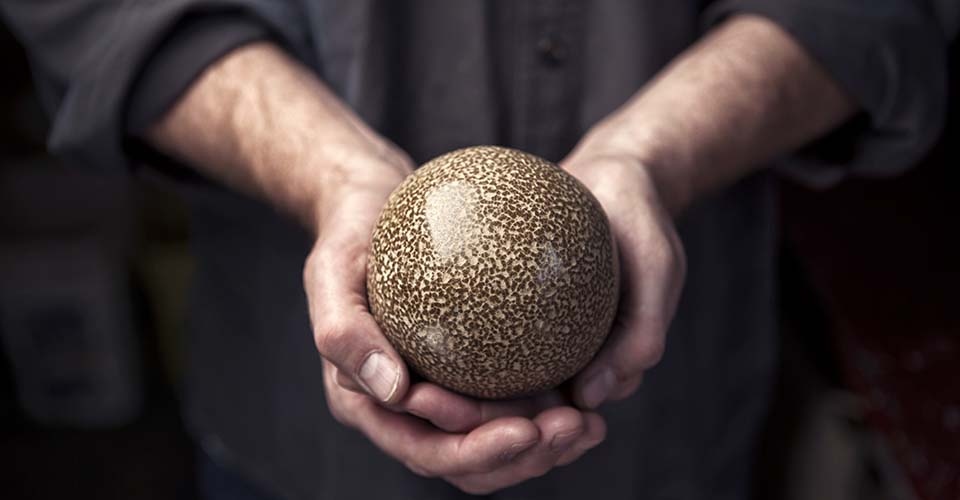 An artist transforms balls of dirt into beautiful, shiny spheres like none you've seen.