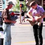 Stranger takes homeless man's sign and rips it up, then reveals magical surprise.