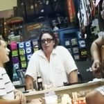 A boy and his dad sing the blues in a guitar shop. The owner can't believe what he's witnessing.