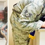 Airman holds dying military dog, then boss orders staff to get American flag quickly.