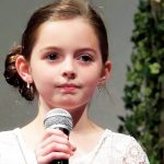 Little girl performs Easter version of 'Hallelujah', paralyzes crowd with her haunting rendition.
