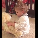 Baby girl gets bear from deployed daddy, watch her flip out when she squeezes its hand.