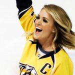 Carrie Underwood gives surprise performance of national anthem at Nashville Predators game.