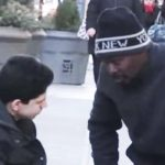 Homeless man is the only person who stops to help the kid freezing on the street.