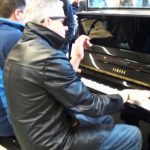 2 men play 'Boogie Woogie Jam' on public piano. Then woman joins in for stunning performance.