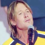 Keith Urban never sang the national anthem. He opens his mouth, and the crowd goes silent.