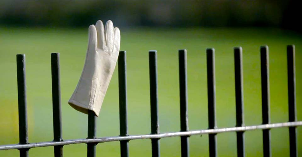 A mysterious man puts a single white glove on a fence. When I see why, I actually laugh out loud.