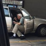 Sweet photo shows elderly man feeding ice cream to his wife on sweltering day.