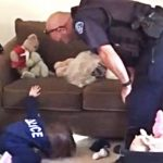 This 4-year-old was scared of monsters in her new house. So a police officer came over to help.