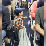 Toddler brings smiles to every passenger on flight with one adorable greeting.