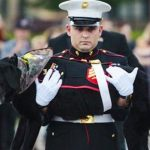 Hundreds gather to give tear-filled goodbye to hero military dog.