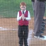 7-year-old with bad case of hiccups powers through national anthem.