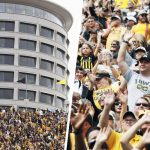 Iowa football crowd stands to wave at children at neighboring hospital.