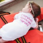 Newborn Hurricane Harvey survivor has photo shoot on the boat that saved her.