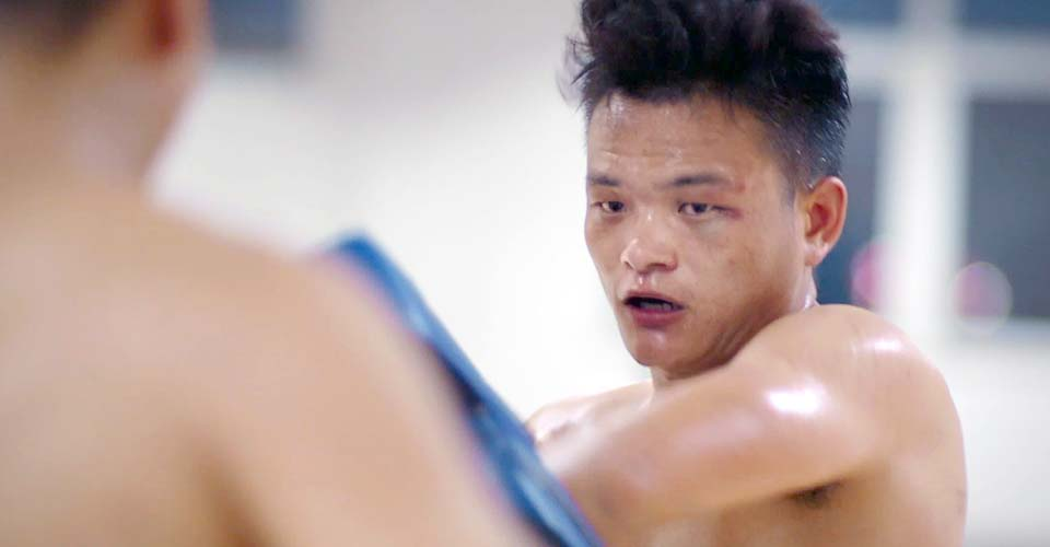 A Chinese factory worker who fights in kickboxing tournaments shows us what courage looks like.