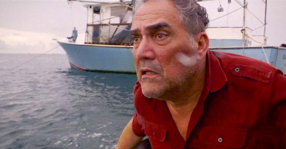 A fisherman tries to smuggle Cuban immigrants into America. But then, he sees a man in the water.